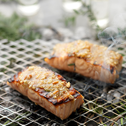 SALMON BARBECUED IN PINE WITH PINE NUT AND PARMESAN PESTO